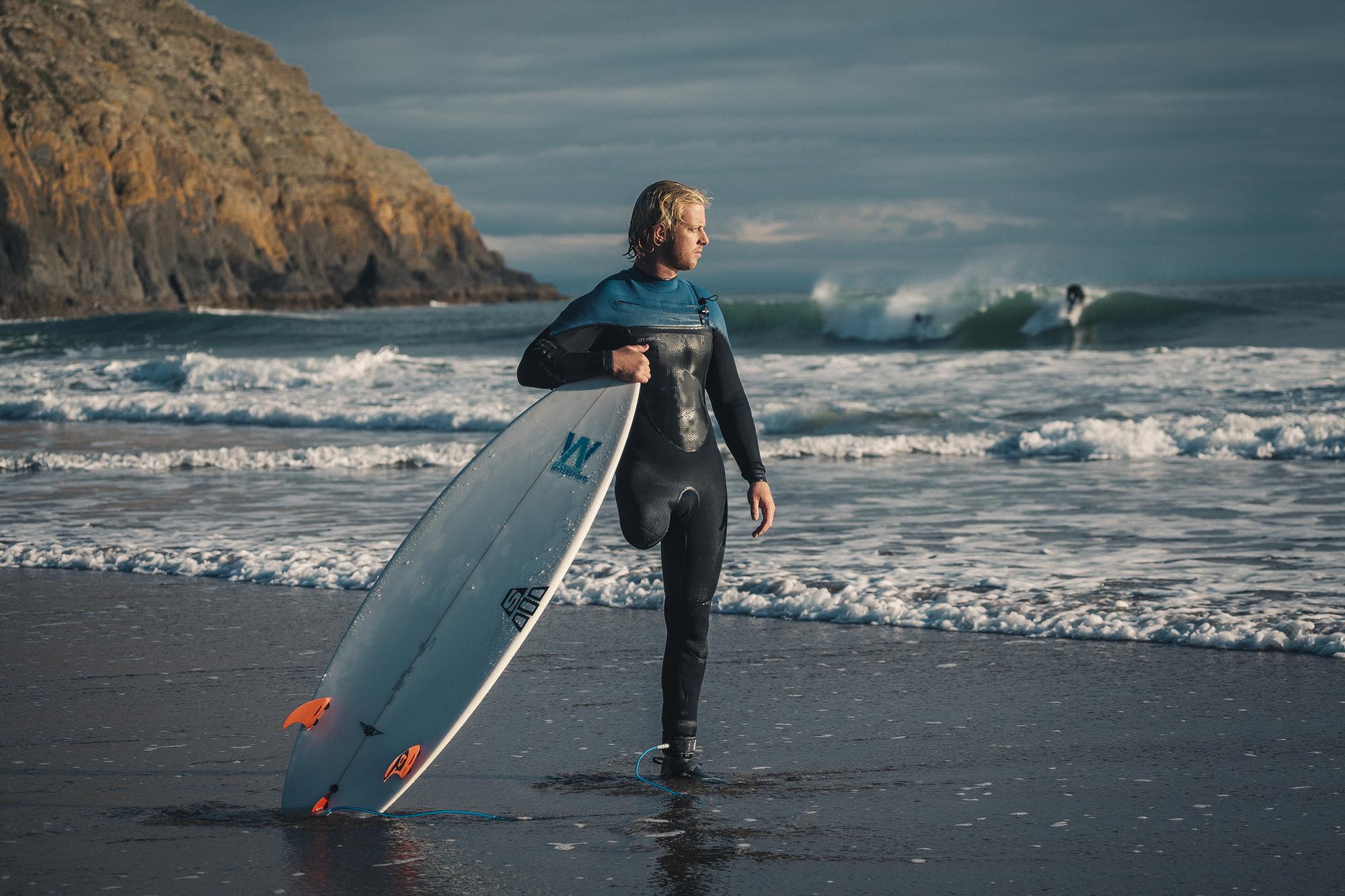 Llywelyn Williams with surf board - Mindset -Create Health